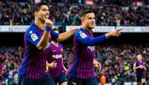 Suárez y Coutinho, en festejo de gol