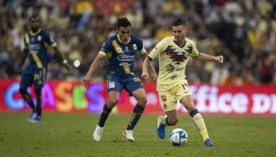 Rocha y Benedetti, durante un partido