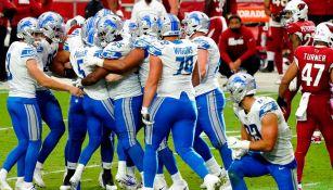 Jugadores de Lions festejan la victoria