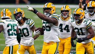 Jugadores de los Packers festejan una anotación