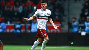 Héctor Moreno durante un partido con México