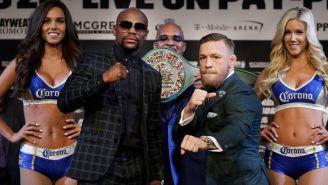 Mayweather y McGregor posan frente al 'Money Belt'
