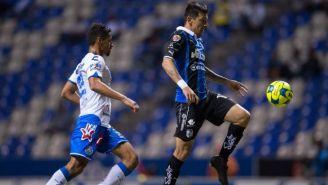 Patricio Araujo y Édgar Benitez en jugada