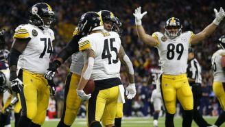 Jugadores de Pittsburgh celebra un Touchdown