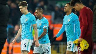 Jugadores del City tras la derrota en Anfield