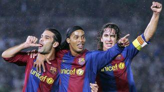 Ronaldinho junto a Rafa Márquez y Puyol