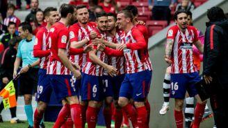 Griezmann festaja su gol contra el Levante con sus compañeros