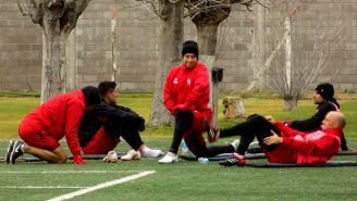 Martín Nervo, al centro de sus excompañeros del Club Atlético Huracán