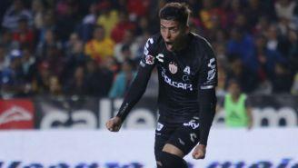 Brian Fernández festejando un gol contra Morelia