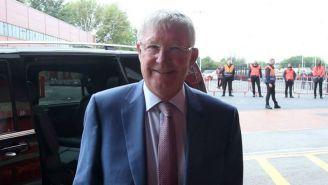Sir Alex Ferguson sonríe a su llegada a Old Trafford