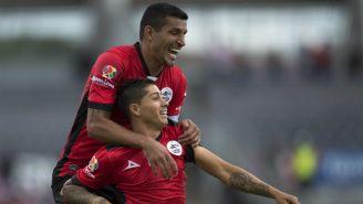 Jugadores de Lobos BUAP festejan un gol