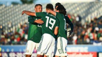 Jugadores de México festejan un gol contra El Salvador