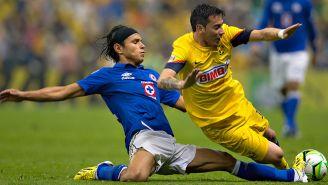 Flores y Sambueza, en una jugada de la Final del Clausura 2013