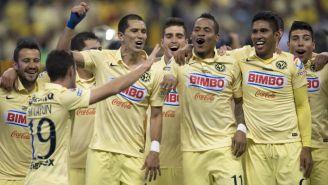 Jugadores de América festejan el título contra Tigres en el 2014