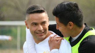 Juninho y Hugo Ayala, en una práctica con Tigres