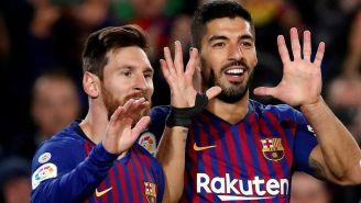 Messi y Suárez celebran una anotación ante el Eibar