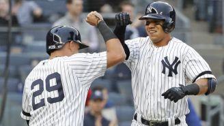 Jugadores de los New York Yankees festejan una carrera