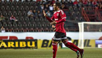 Luis Gerardo Chávez festeja un gol con Xolos