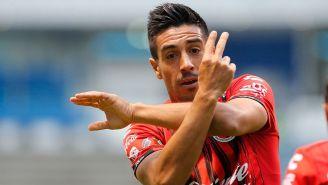 Washington Camacho festeja un gol contra Puebla