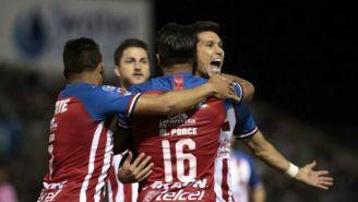 Ponce y Molina festejan gol ante Juárez