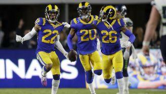 Jugadores de los Rams festejan la victoria