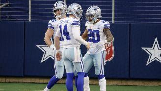 Jugadores de los Dallas Cowboys festejan un TD