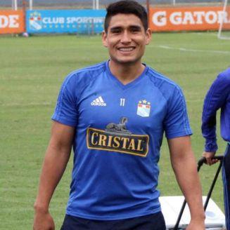 Irven Ávila sonríe en una foto con Sporting Cristal