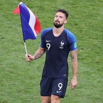 Olivier Giroud, con la bandera de Francia tras ganar el Mundial