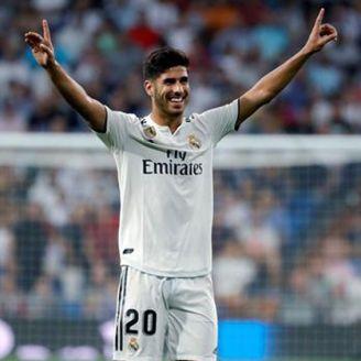 Asensio celebra una victoria del Real Madrid