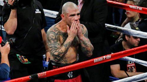 Miguel Cotto se lamenta después de caer frente a Sadam Ali