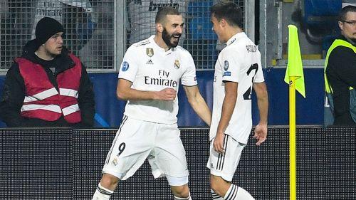 Benzema festeja uno de sus dos goles en Champions