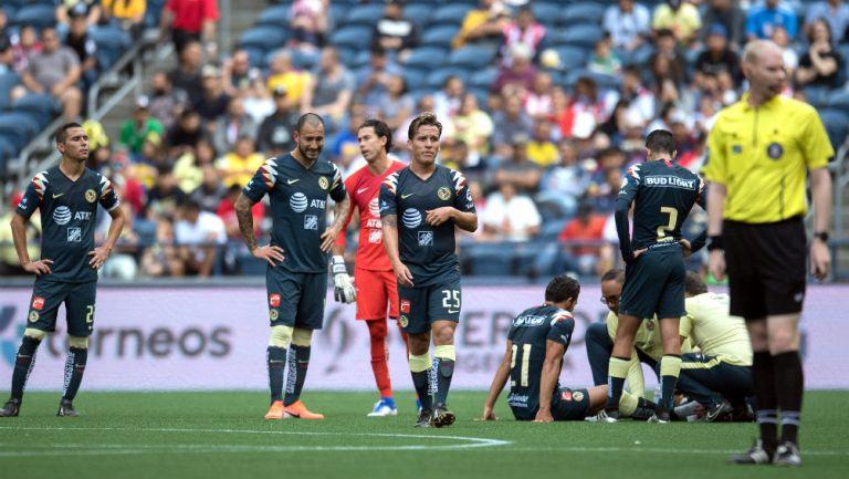 Jugadores de América durante un encuentro ante el River Plate