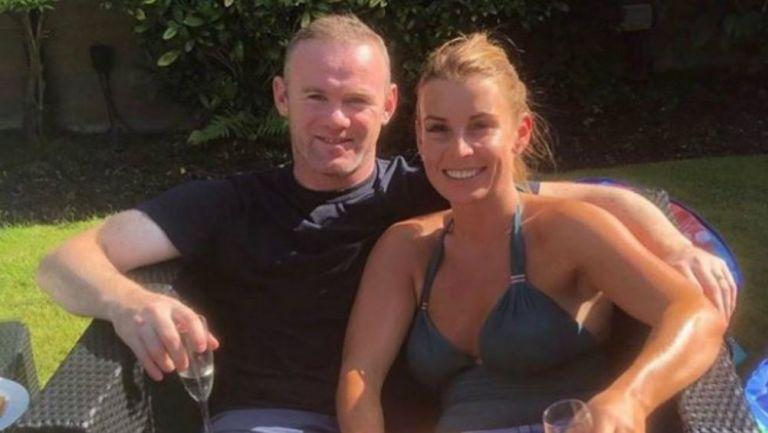 Wayne Rooney junto a su esposa Coleen