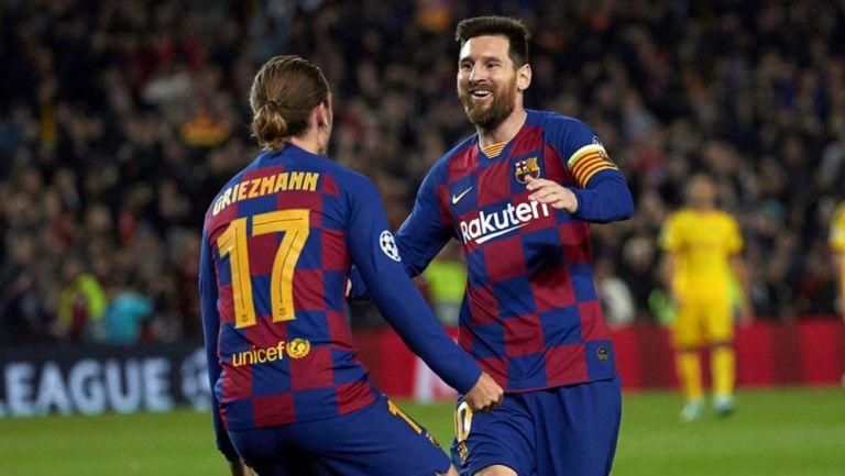 Messi celebra con Griezmann su gol ante el Dortmund